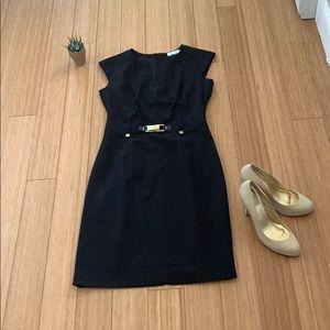 Calvin Klein black dress with gold buckle